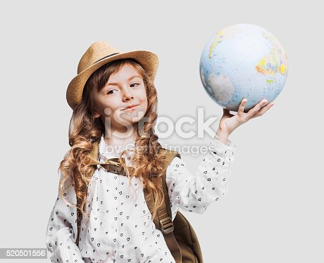 istock Happy little girl holding globe 520501556
