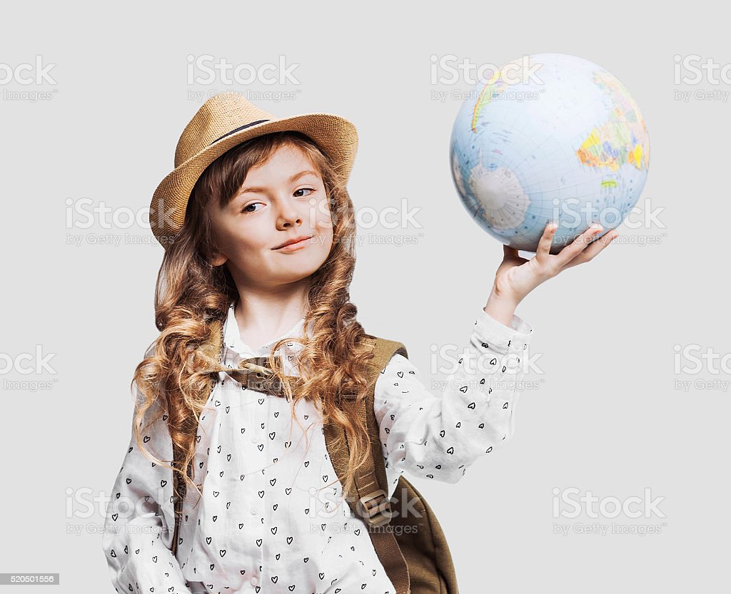 Happy little girl holding globe stock photo