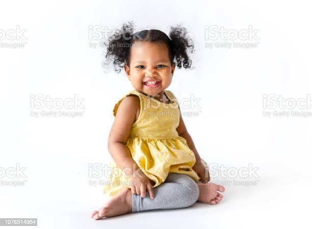 Happy little girl in a yellow dress sitting picture id1076514954?b=1&k=6&m=1076514954&s=612x612&h=yrtxujz 7kkrrbvgj815kyede0dgbdnsf3g0dmk a9k=