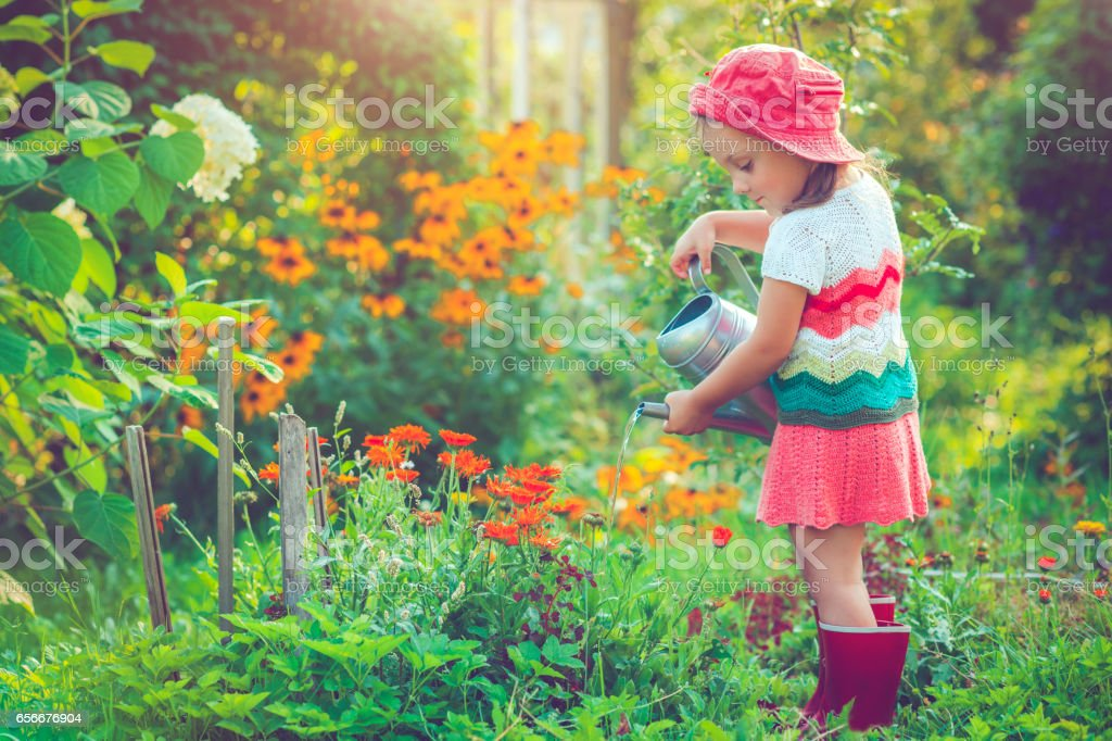 Happy little girl in garden stock photo