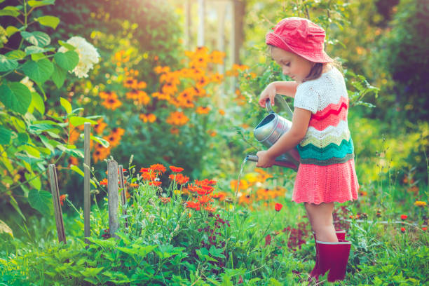 Happy little girl in garden Happy child gardening in summer russian dacha stock pictures, royalty-free photos & images