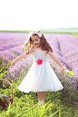 Happy little girl in lavender field