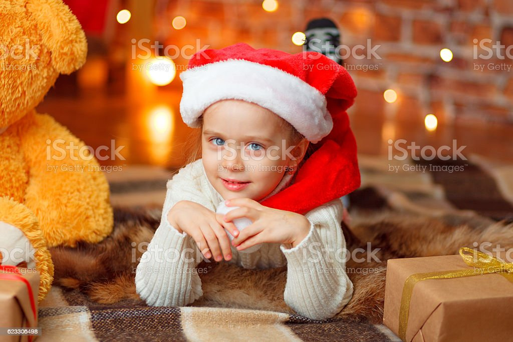 Happy little girl in santa's hat stock photo