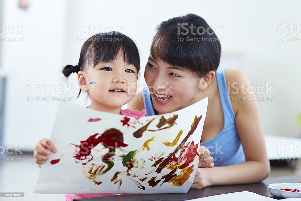 happy little girl indoor with pretty young woman stock photo