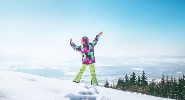 Happy little girl jumping on the snow hill picture id1048872952?b=1&k=6&m=1048872952&s=612x612&w=0&h=jqftrskesiqfpeypcqsbcrcg2yxzbikycr2txa4d7ne=