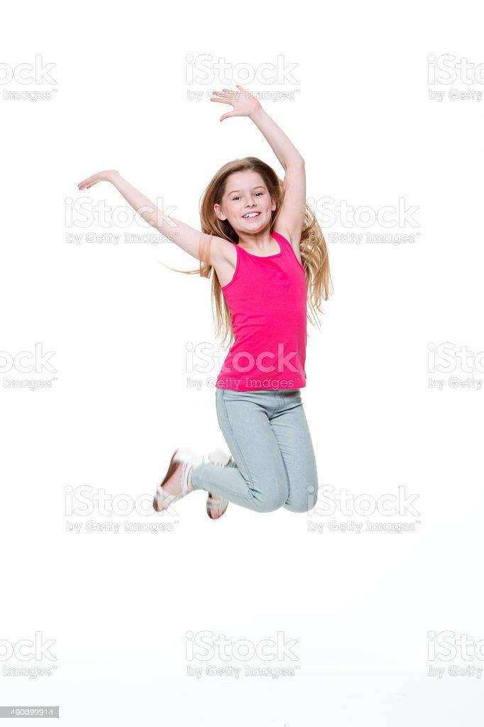 Heureuse petite fille sauter - Photo