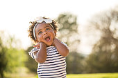 istock Happy little girl laughing and smiling outside. 969921038