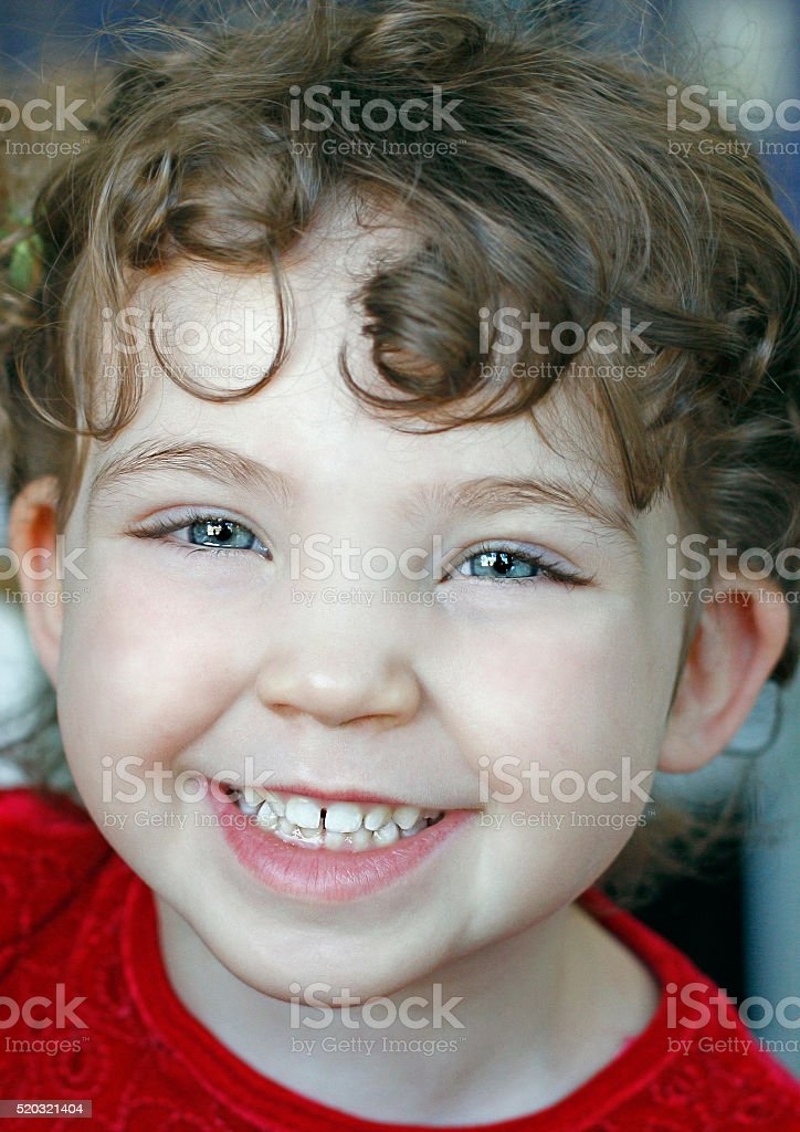 Happy little girl, laughing and smiling stock photo