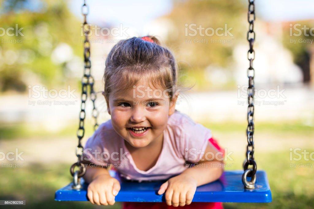 Happy little girl on swing royalty-free stock photo