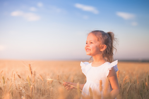 istock Happy Little Girl Outdoor At Wheat Field. End of Summer 1018842400