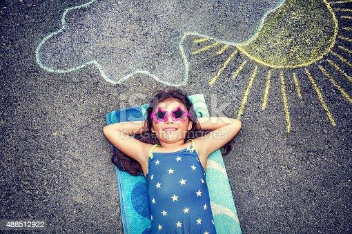 istock Happy little girl outdoors 488512922