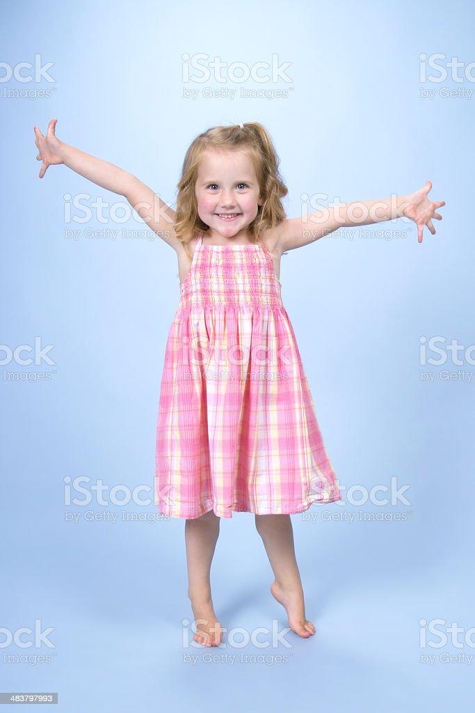 Счастливая маленькая девочка стоковое фото
