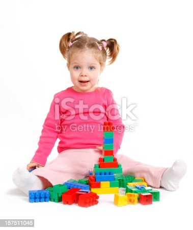 istock Happy little girl playing with blocks 157511045