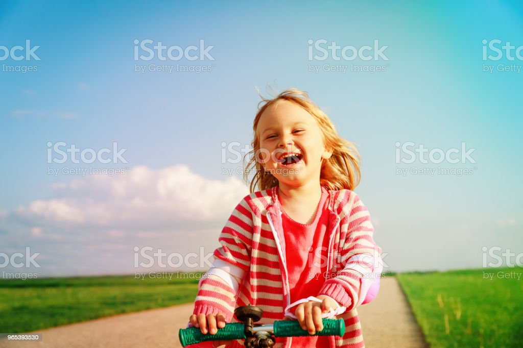happy little girl riding scooter in summer royalty-free stock photo