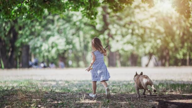 Happy little girl running with her dog picture id1173371808?b=1&k=6&m=1173371808&s=612x612&w=0&h=orwhhgdwewf21fjbi4xcgbbemupqgabbmdsheujsz3w=