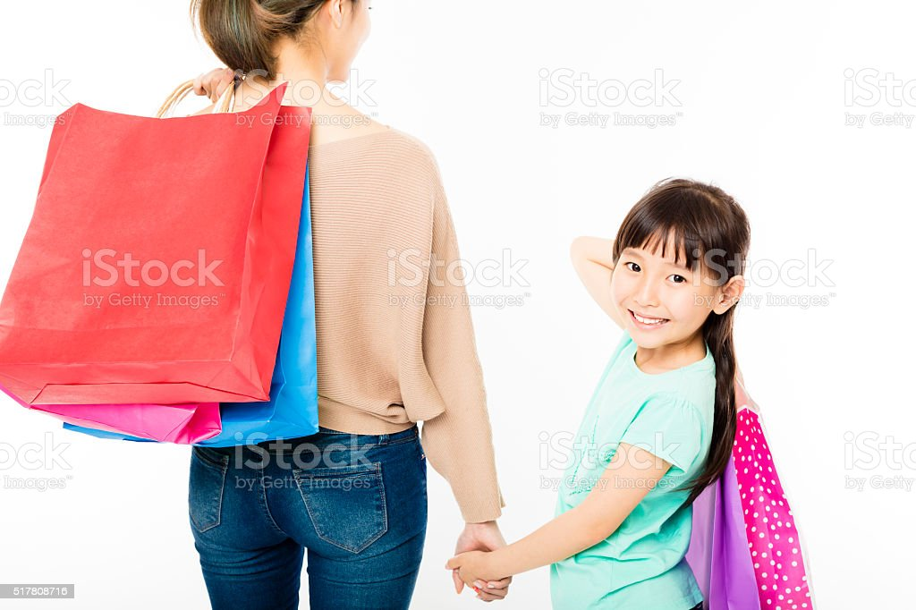 happy little girl shopping with mother stock photo