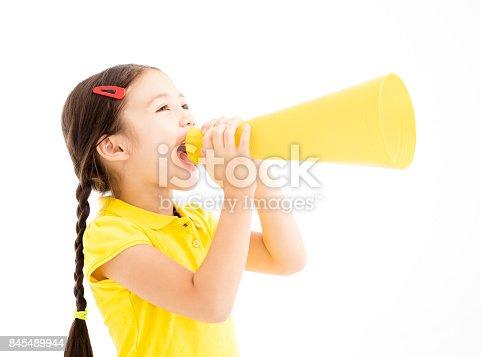 istock happy little girl shouting by megaphone 845489944