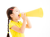 happy little girl shouting by megaphone