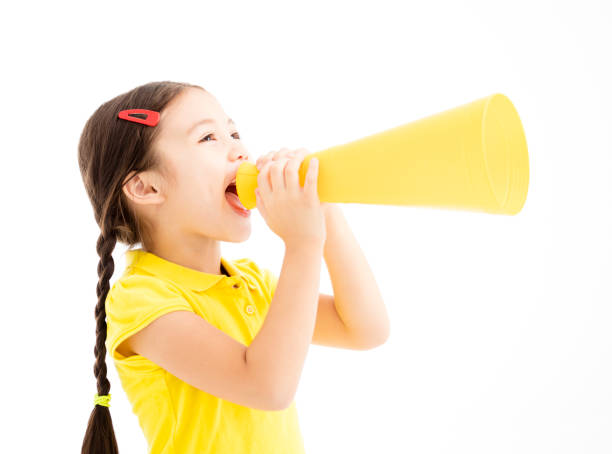 happy little girl shouting by megaphone - shouting stock photos and pictures