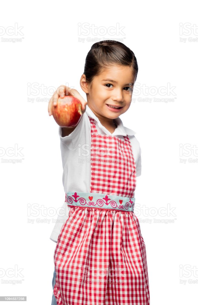 Happy little girl showing an apple stock photo