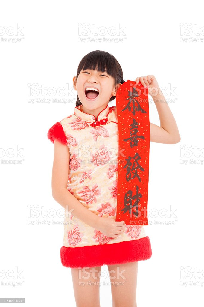 happy little girl showing red couplets for chinese new year stock photo