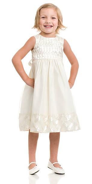 Happy Little Girl Standing In Dress stock photo