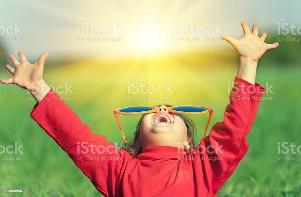 Happy little girl wearing big sunglasses  enjoying sun stock photo