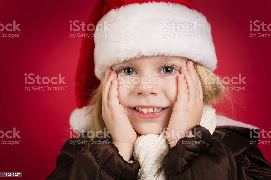 e1ce3ba98e Happy Little Girl Wearing Santa Hat With Red Background Stock Photo ...