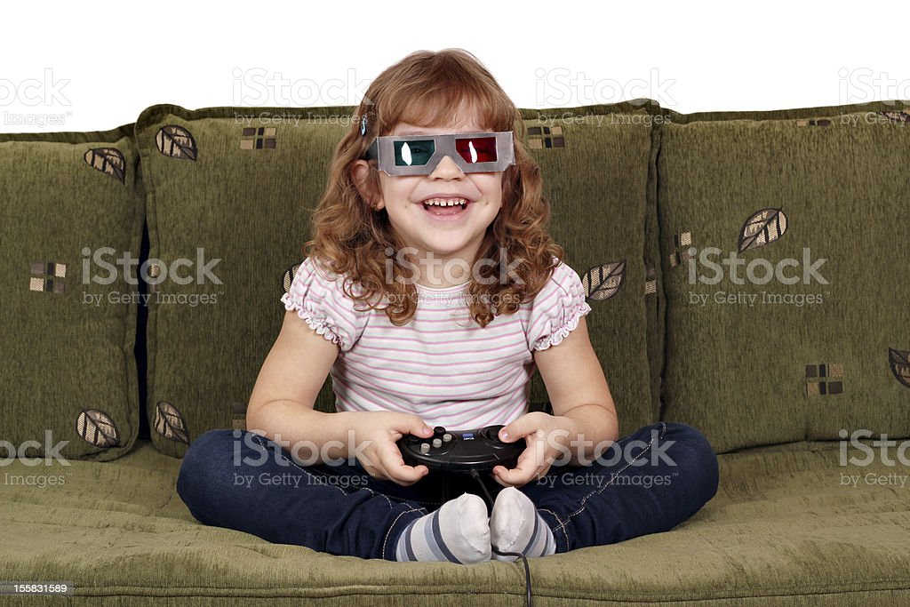 happy little girl with 3d glasses play video game royalty-free stock photo