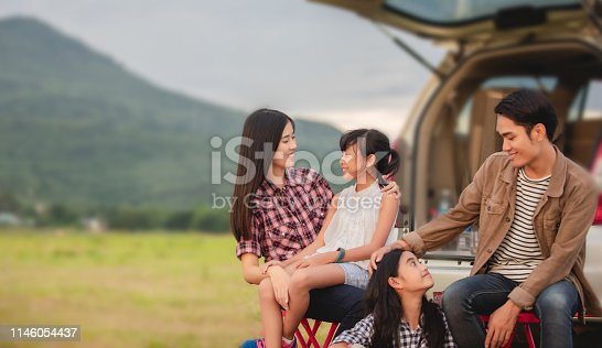 849398784 istock photo Happy little girl  with asian family sitting in the car for enjoying road trip and summer vacation in camper van 1146054437