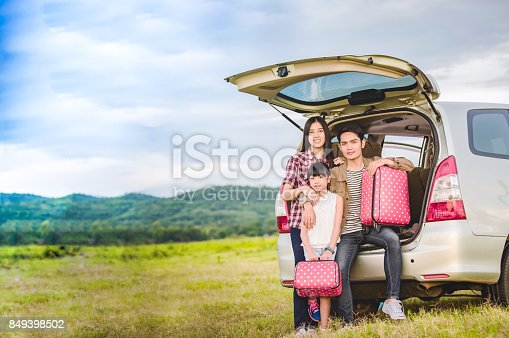 849398784 istock photo Happy little girl  with asian family sitting in the car for enjoying road trip and summer vacation in camper van 849398502