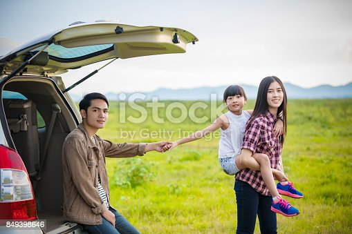 849398784 istock photo Happy little girl  with asian family sitting in the car for enjoying road trip and summer vacation in camper van 849398646