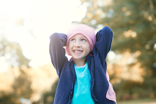 Happy little girl with cancer