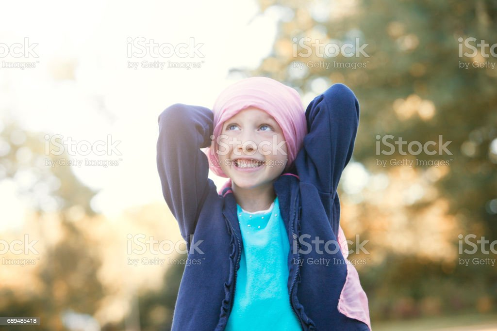 Happy little girl with cancer stock photo