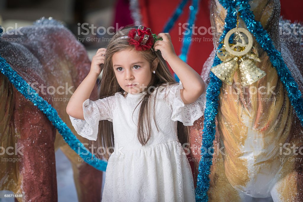 happy little girl with Christmas car  and Christmas Deer royalty-free stock photo