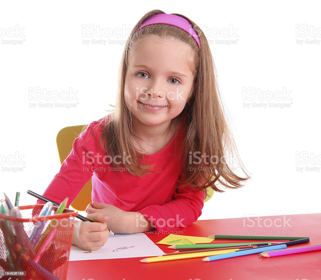 Happy little girl with crayons royalty-free stock photo