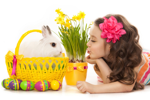 istock Happy little girl with easter rabbit and eggs 482353519