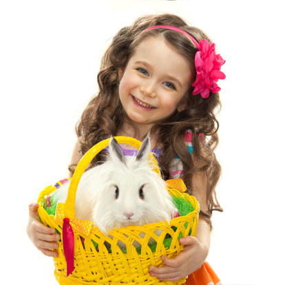 istock Happy little girl with easter rabbit 482249601