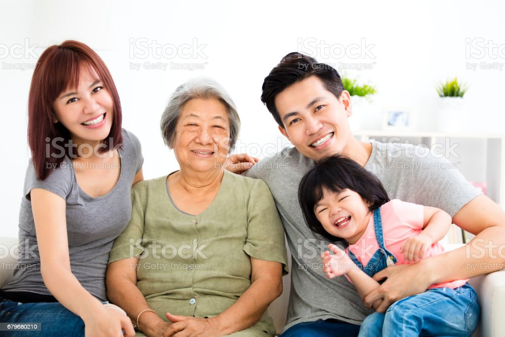 happy little girl with her grandmother and parent stock photo