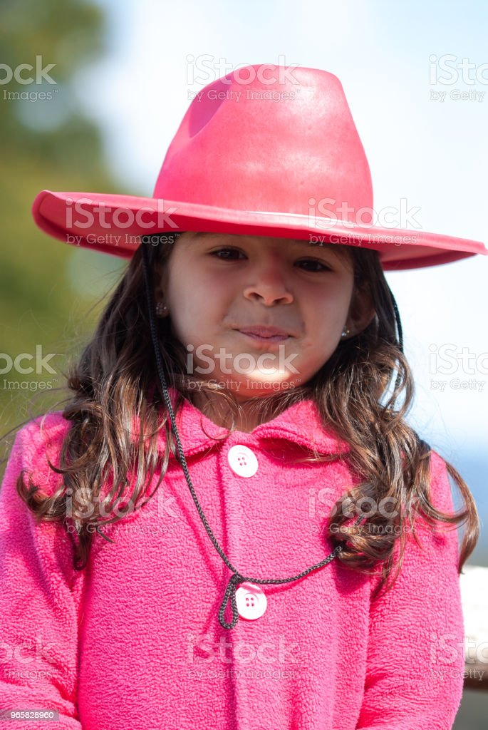 Happy little girl with her pink cowboy's owl in the farm house. - Royalty-free 4-5 Years Stock Photo