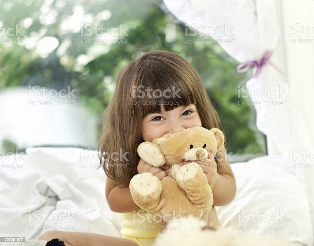 Happy Little Girl with Teddy Bear stock photo