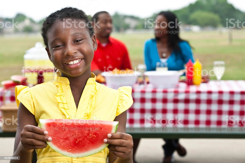Happy Little Girl With Watermelon at her Family Picnic stock photo
