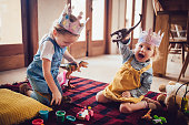Happy little girls having fun playing with toys