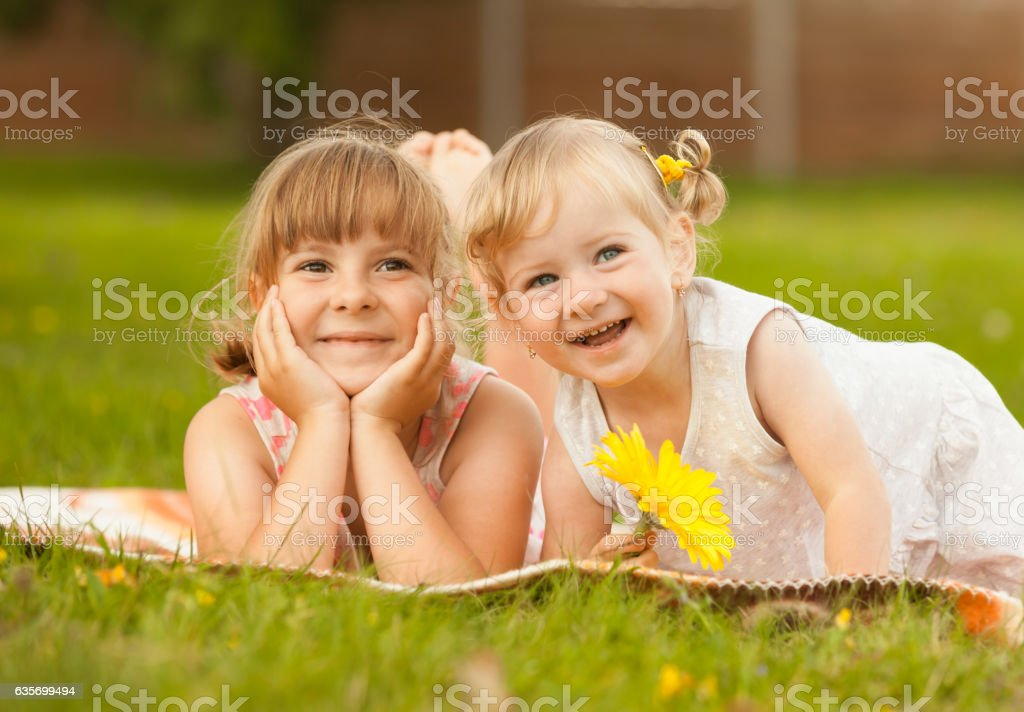 Happy little girls in the park royalty-free stock photo