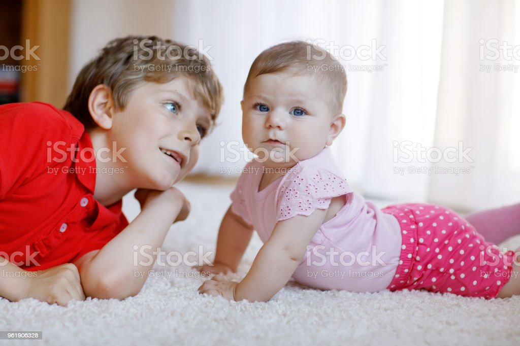 Happy Little Kid Boy With Newborn Baby Girl Cute Sister Siblings