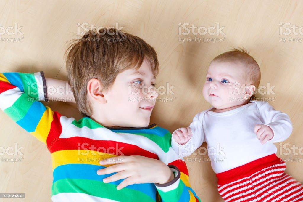 2dc4bcaa44ab7 Happy Little Kid Boy With Newborn Baby Sister Girl Stock Photo ...