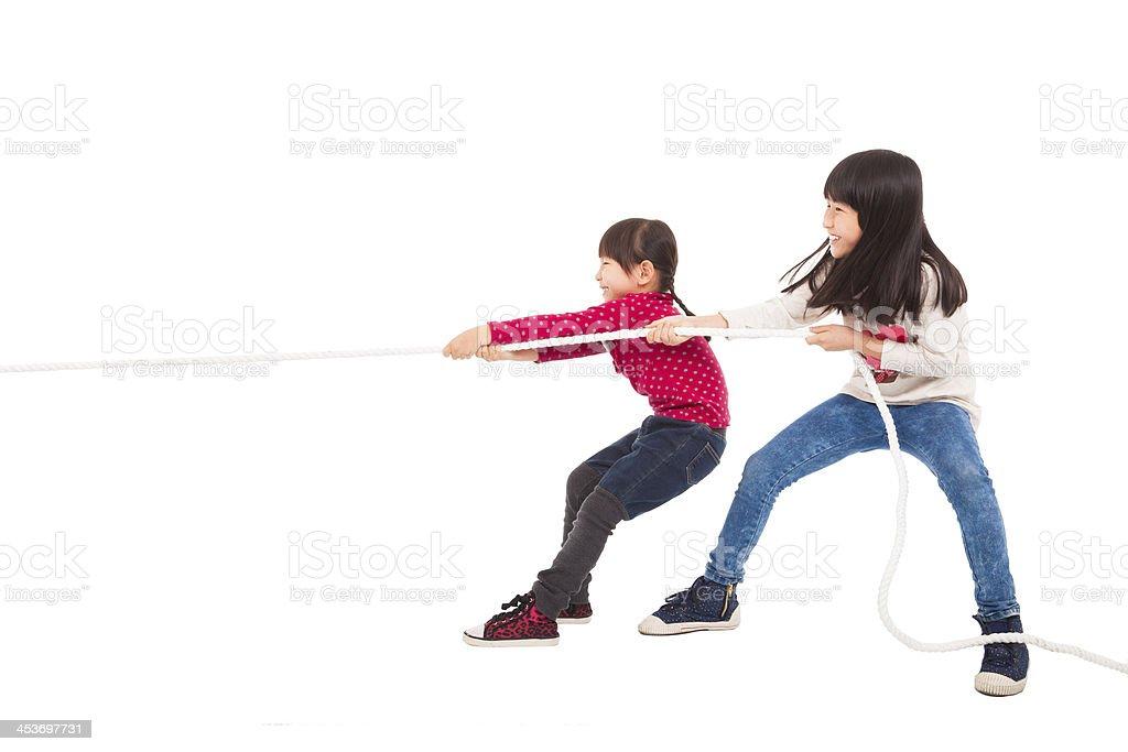 happy Little Kids playing Tug of War stock photo