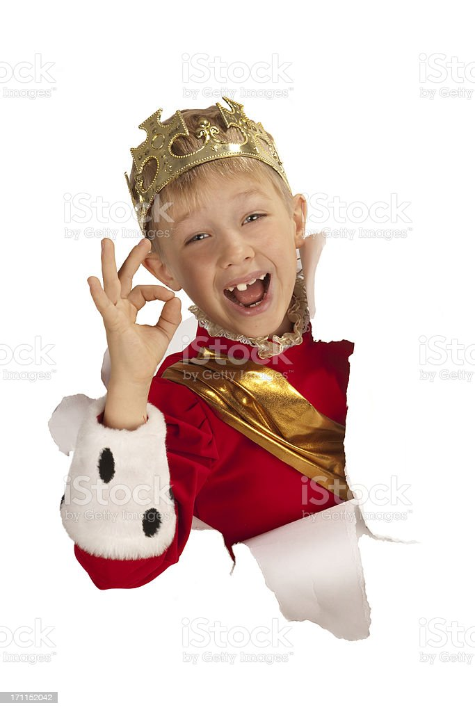 Happy little king  looking out from the paper. stock photo