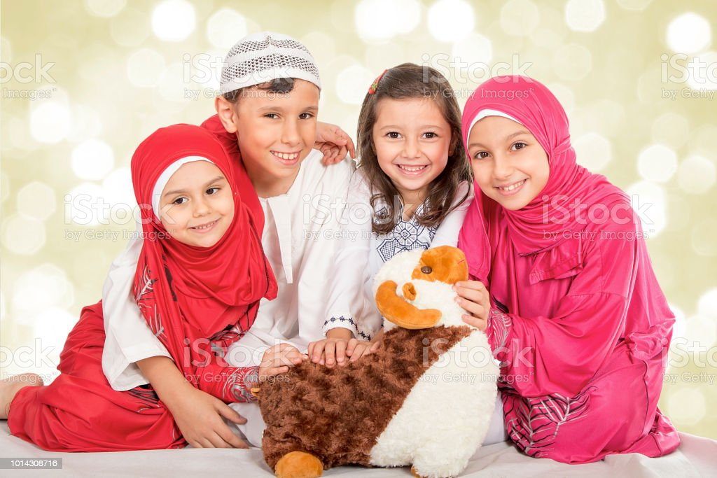 Happy little Muslim family celebrating Eid ul Adha stock photo