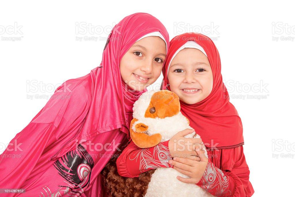 Happy little Muslim girls celebrating Eid ul Adha stock photo